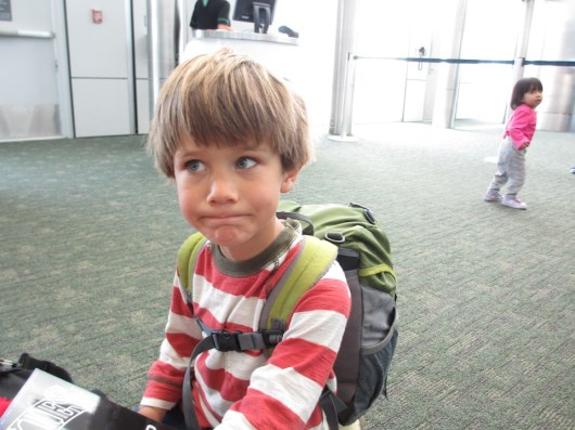 Tory, leery of airport security. Or the girl behind him...
