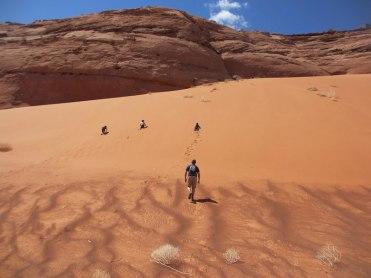 The boys climbing the sand hill. Fun run down.
