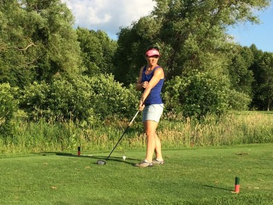 Kari eyes up the competition from the tee. Keep your eye on the ball Kari.