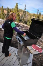 Kari grills up dinner. Steak and shrimp!