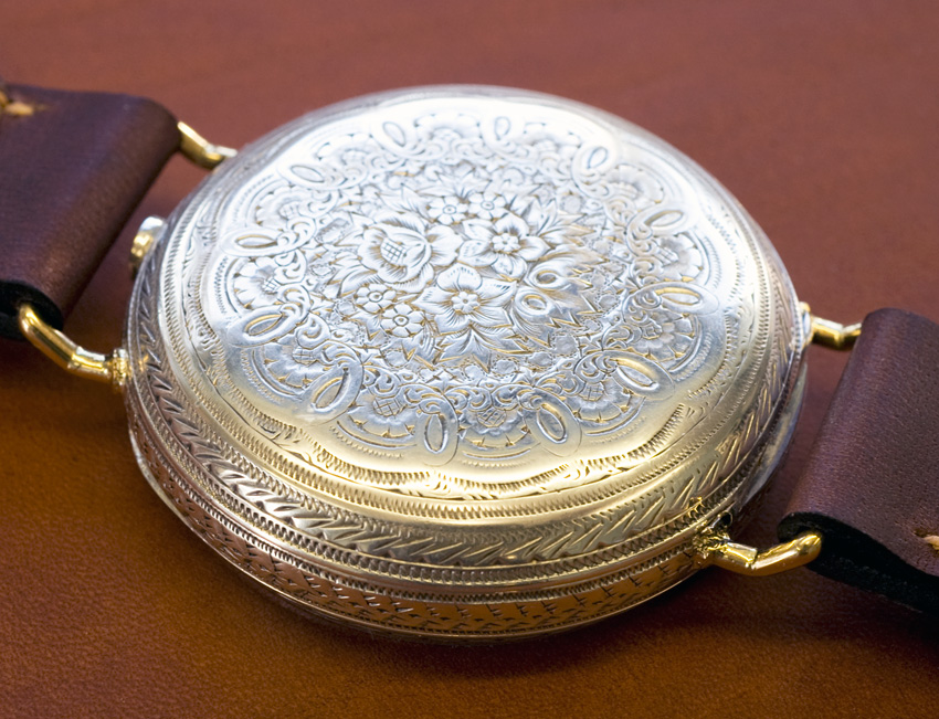 silver pocket watch circa 1870 transforned to wrist watch with fixed bars showing engraving on case
