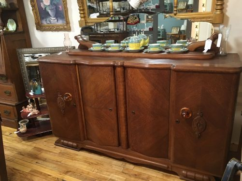 Gorgeous credenza with original scalloped mirror.