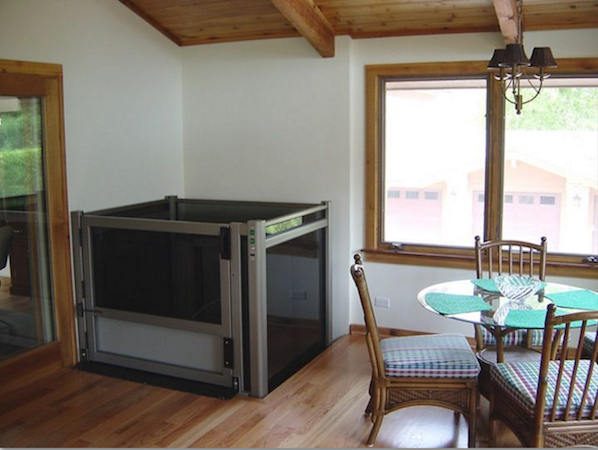 Total Access offers residential vertical platform lifts with custom enclosures