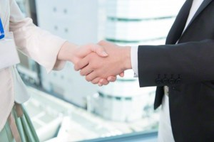 Business People Shaking Hands --- Image by © Top Photo Corporation/Corbis