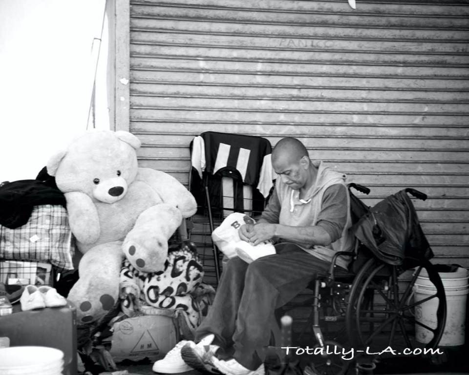 Disabled homeless man with his last possessions