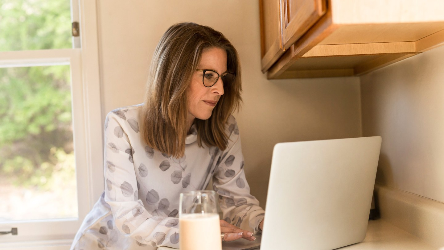 A woman working on her computer at home