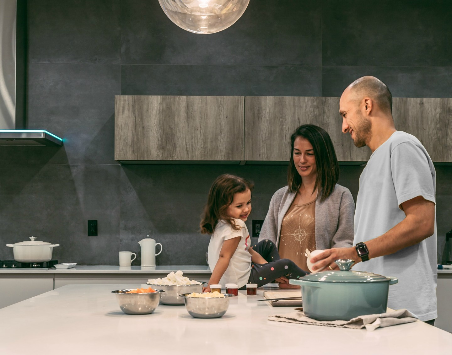 a family making dinner together in the kitchen