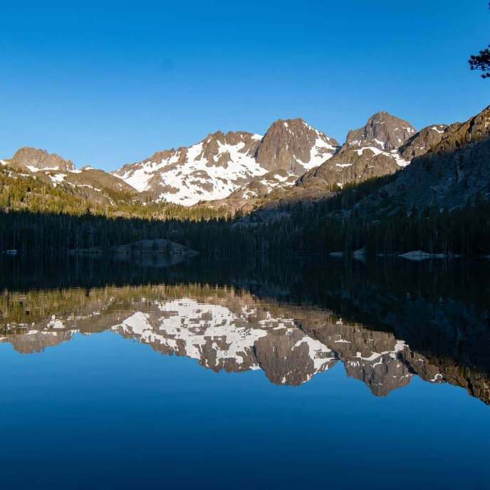 Mt Ritter and Banner Peak Mt Ritter and Banner Peak reflect in Shadow Lake on a serene summer morning.