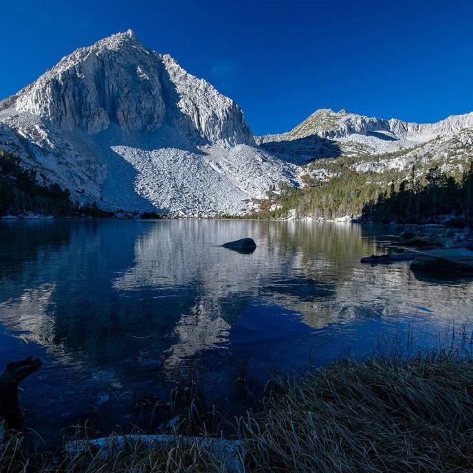 Frosty reflection of Patricia Peak in Hilton Creek Lake.
