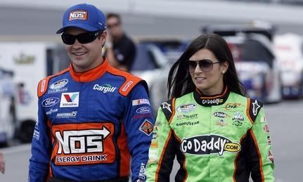 Ricky Stenhouse, Jr and Danica Patrick walking through the pits together. LAT PHOTOGRAPHIC