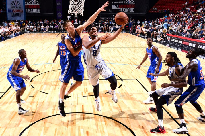 LAS VEGAS, NV - JULY 14:  Jahlil Okafor #8 of the Philadelphia 76ers shoots the ball against Kristaps Porzingis #46 of the New York Knicks during the 2015 NBA Las Vegas Summer League game on July 14, 2015 at the Thomas & Mack Center in Las Vegas, Nevada. NOTE TO USER: User expressly acknowledges and agrees that, by downloading and or using this photograph, User is consenting to the terms and conditions of the Getty Images License Agreement. Mandatory Copyright Notice: Copyright 2015 NBAE  (Photo by David Dow/NBAE via Getty Images)