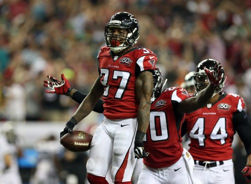 Sep 14, 2015; Atlanta, GA, USA; Atlanta Falcons cornerback Ricardo Allen (37) celebrates his game saving interception in the fourth quarter against the Philadelphia Eagles at the Georgia Dome. The Falcons defeated the Eagles 26-24. Mandatory Credit: Jason Getz-USA TODAY Sports