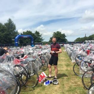 TTT athlete George Robinson racking his bike
