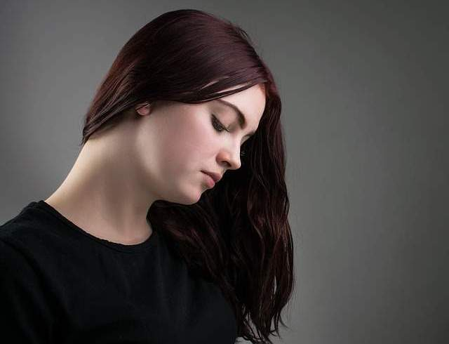 Image showing a woman considering the first symptoms of pregnancy.
