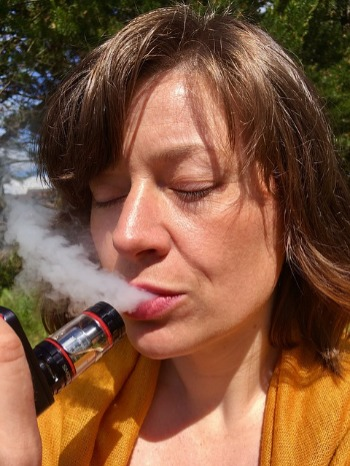 Image shows e-Cigarettes smoking which is also to be avoided during pregnancy.