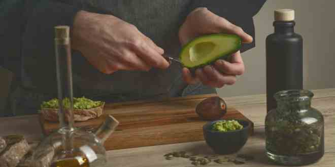 Chef making avocado sandwiches with bread,