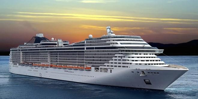 Luxury cruise ship sailing from port on sunset.