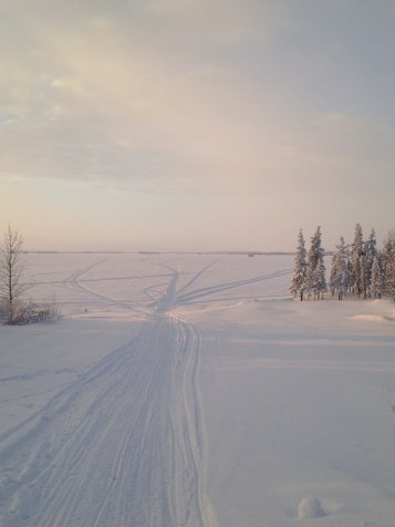 Skidoo tracks to who knows where? But seriously. These could be going anywhere. Locals have cabins all over the place, and fishing nets too.