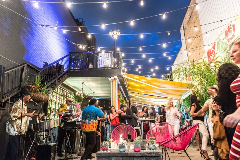 Patio at Barrio transformed into Playa Bacardi serving summer cocktails.