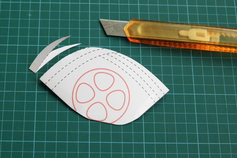 If the paper mask is too big, cut away the first line near to the chin-edge. Put it on the user's face again to test the size.