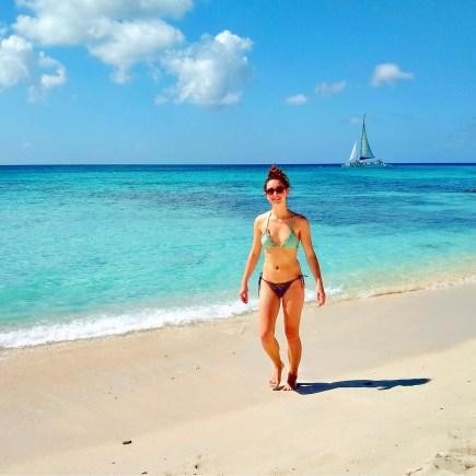 Ellen on Palm Beach of Aruba for Ellen Blazer's travel blog To Travel and Bloom