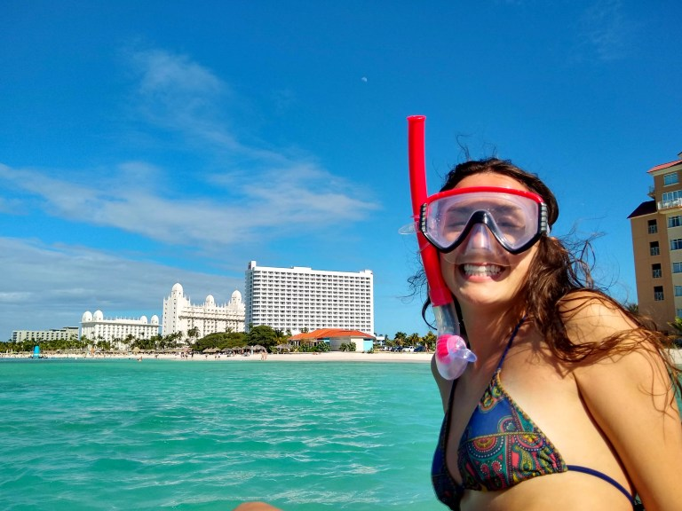 Ellen ready to snorkel in the waters of Palm Beach, Aruba for Ellen Blazer's travel blog To Travel and Bloom