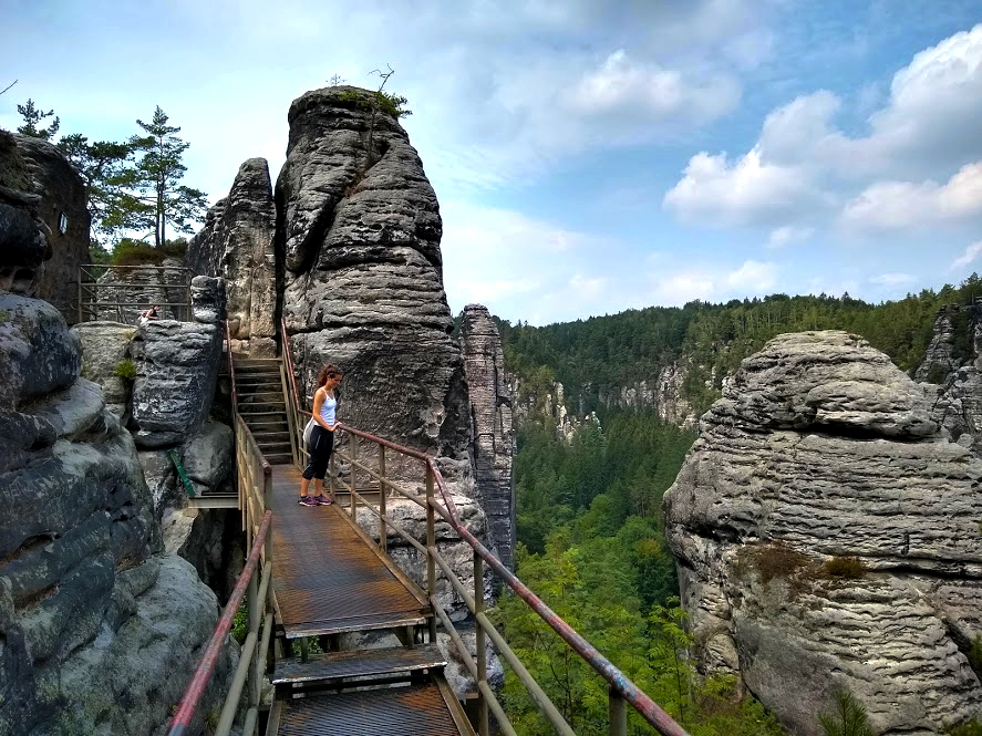 Ellen hiking in Saxon Switzerland National Park near Bastei Bridge on a day trip outside of Dresden, Germany, for Ellen Blazer's travel blog To Travel and Bloom