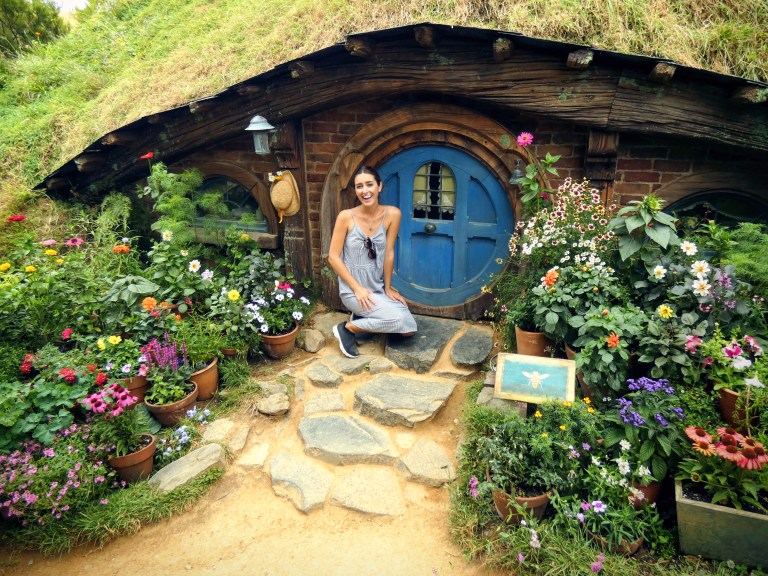 Pretending to be a hobbit at Hobbiton in New Zealand, for Ellen Blazer's travel blog To Travel and Bloom