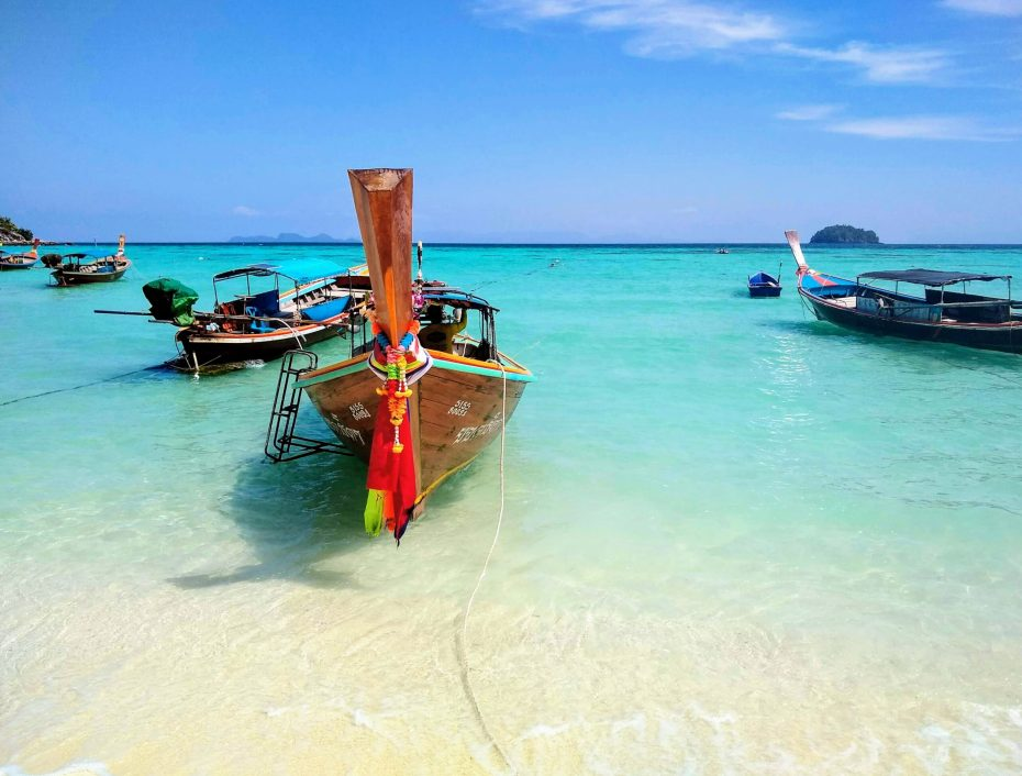Longtail boats in Koh Lipe scaled - Home