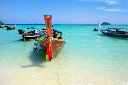 Longtail boats in Koh Lipe scaled - What To Do in Koh Lipe - My Favorite Thai Island