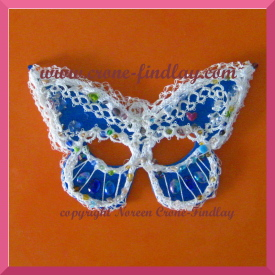 mardi-gras-blue-mask-0n-orange-275