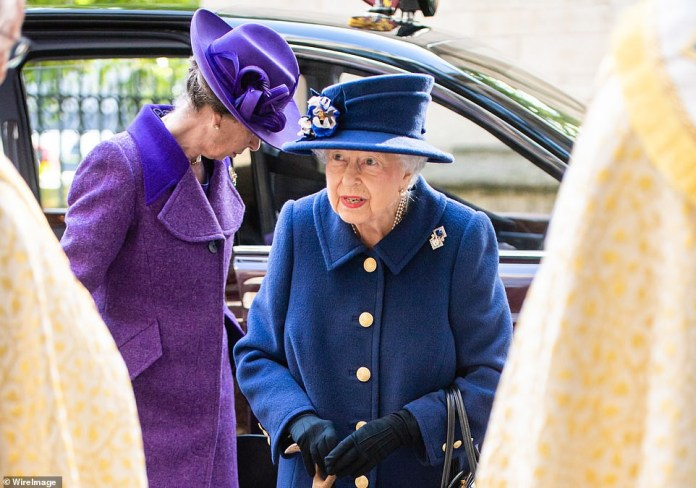 Queen Elizabeth, 95, uses walking stick for for the first time in 18 years  as she