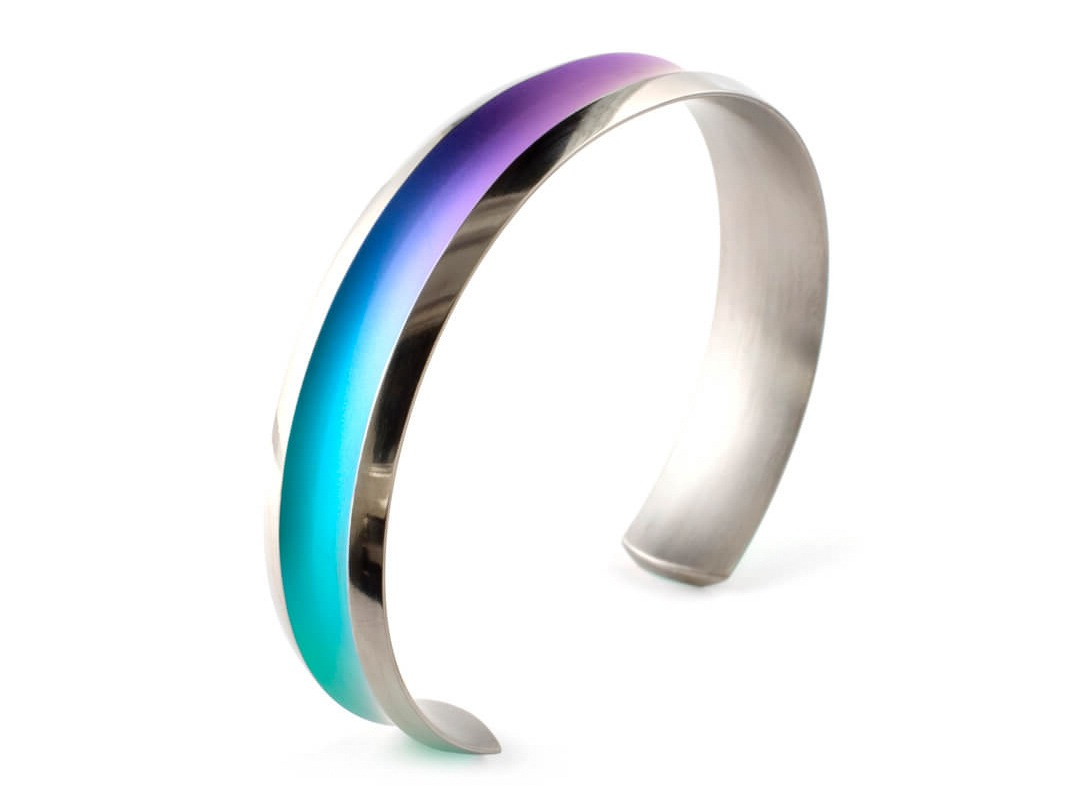 Court rainbow bangle (L) on TouchTitanium.com Our single twist drops - much like the double twist drops - are a popular model in the wire range. Featuring one perfect curve measuring 40mm tall. Available in a select range of colours, including rainbow.