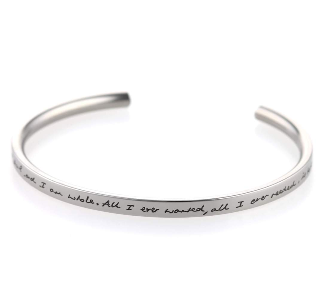 Custom engraved titanium bangle on TouchTitanium.com Personalise your titanium bangle with a message of your choice. Hypoallergenic and safe to wear for all skin types. Available in three sizes. 65mm is standard.