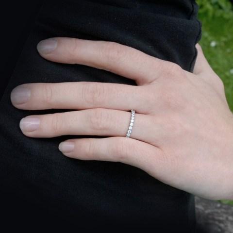 Titanium eternity ring worn on the finger.