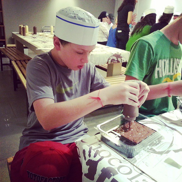 Kids making their own chocolate bars.