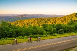 Bob Bryant, Joe Driver, and Elizabeth Harrison bike the Blue Ridge Parkway.