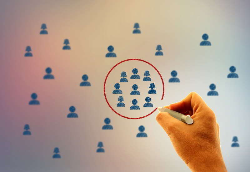 stockvault--businessman-drawing-a-circle-around-people-icons178079-Jack Moreh-web