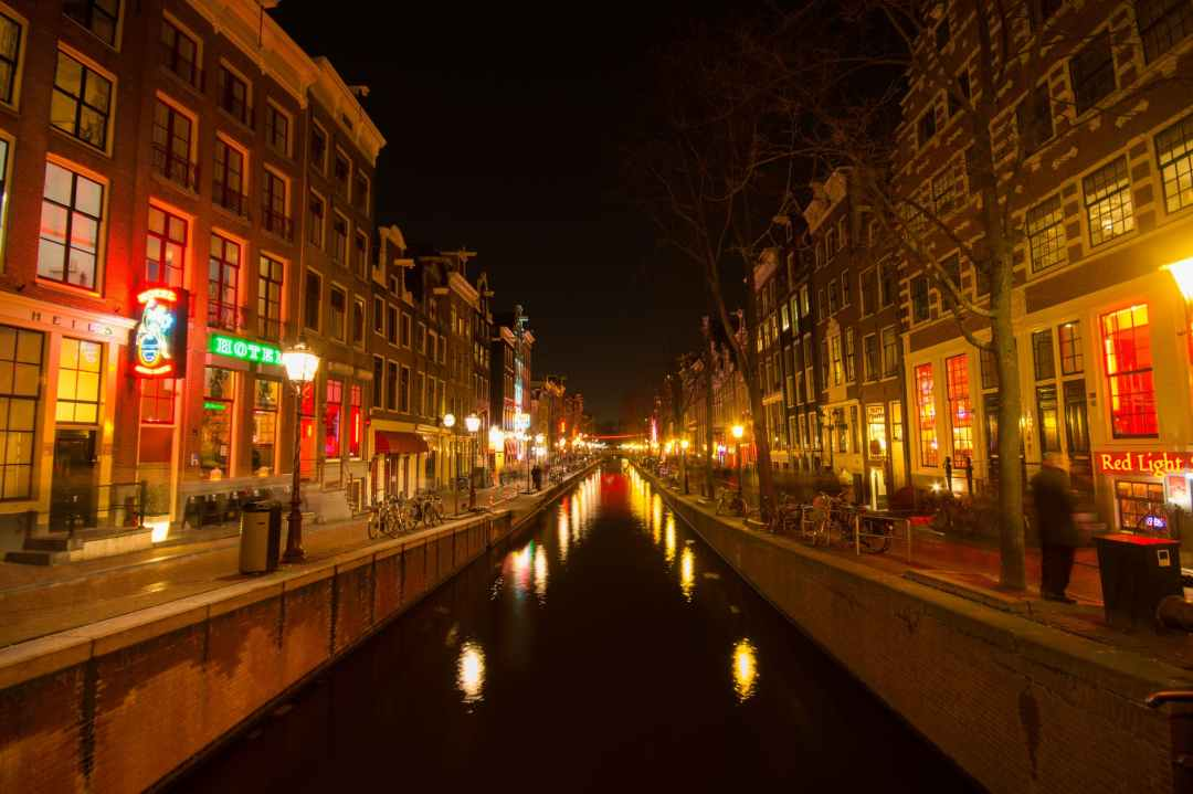amsterdam canal lights red light district ethical tourism