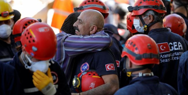 A Grateful Turkish Man Thanking Rescue Workers for Taking his 3 Children out of the Collapsed Apartment in Izmir, Turkey