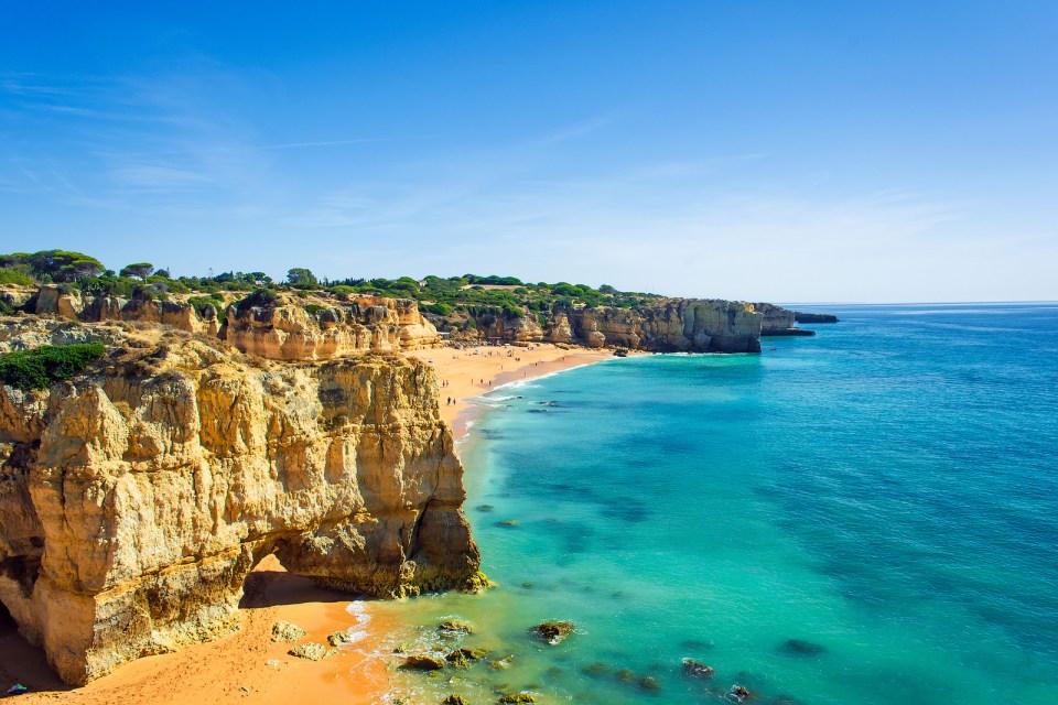 a view of beautiful sandy beach Dona Ana in Lagos Algarve region Portugal