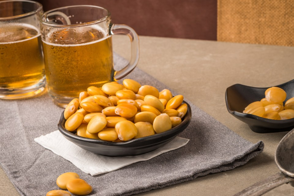 This image has an empty alt attribute; its file name is bigstock-tasty-lupins-and-glass-of-beer-208452799.jpg