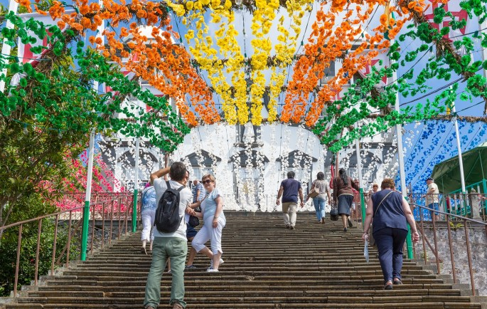 Tourists Climbings Stairs With Flower Decorations Of Church In M