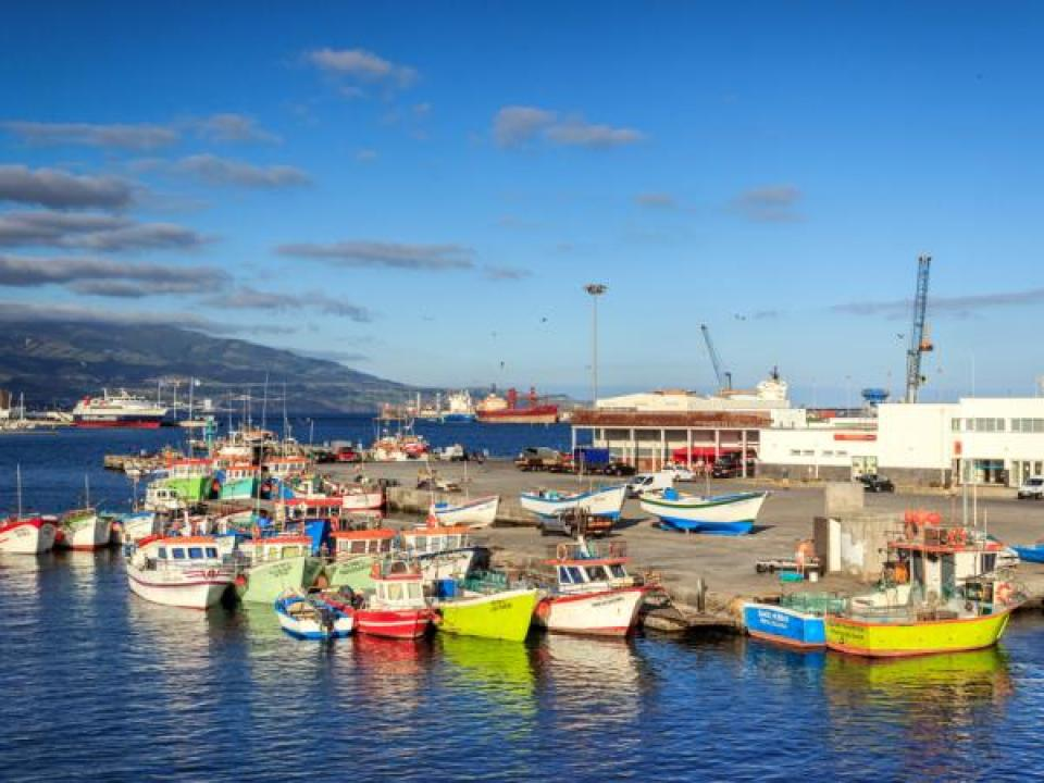 Azores Fishermen and boats on Sao Miguel island blue sky and ocean