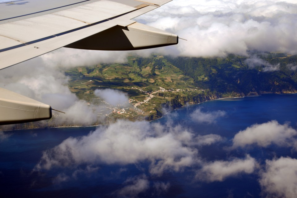 airplane crew out window looking at sao miguel island in the azores
