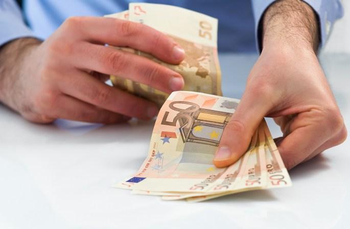 Man hands handling fan fifty euro money.