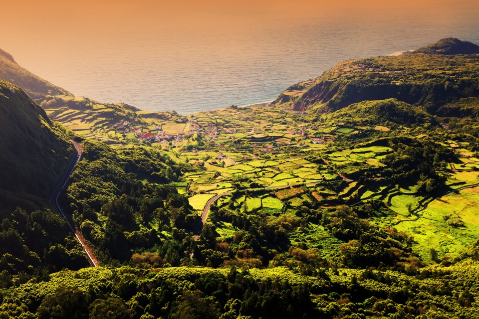 sunset on flores island in the Azores overlooking the city and town