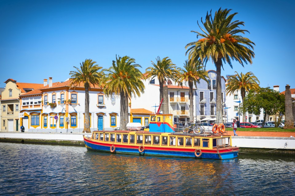 Typical houses at Vouga river. Aveiro, Portugal with boat tour