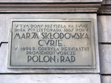 M. Curie memorial plaque on the building she was born in (now Museum)