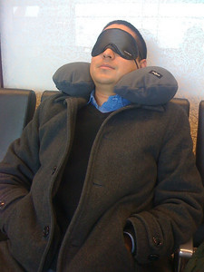 JP relaxes with his neck pillow and eye-mask.